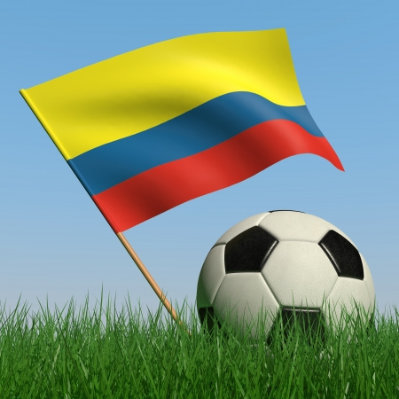 Soccer ball in the grass and the flag of Colombia against the blue sky. 3d photo