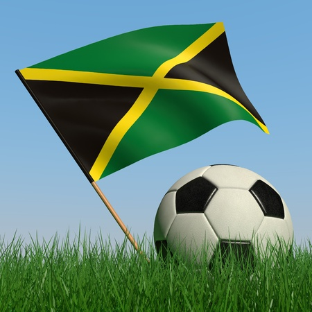 Soccer ball in the grass and the flag of Jamaica against the blue sky. 3d photo