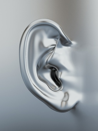 Three dimensional silver metallic human ear. 3d photo