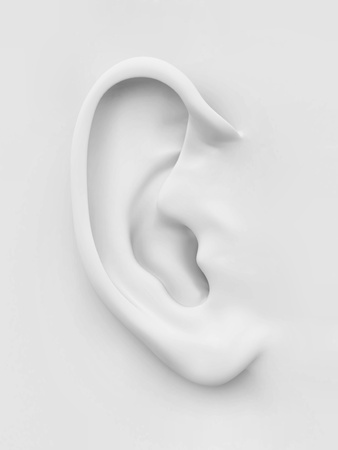 Three-dimensional white soft human ear on white background. 3d photo