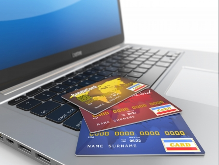 e card: E-commerce  Credit cards on laptop  Three-dimensional image