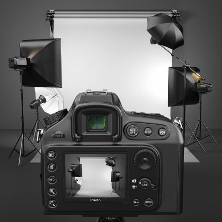 Digital photo camera in studio with soft box and flashes photo