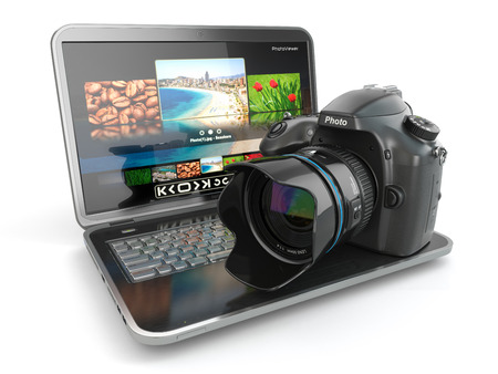 photo equipment: Digital photo camera and laptop. Journalist  or  traveler equipment. 3d Stock Photo