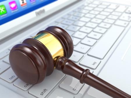 Online judgement. Gavel on laptop. Conceptual image. 3d photo