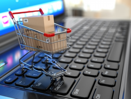 E-commerce. Shopping cart with cardboard boxes on laptop. 3d Stock Photo