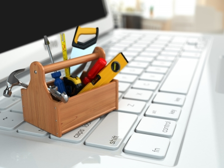 Online support. Toolbox with tools on laptop. 3d Stock Photo