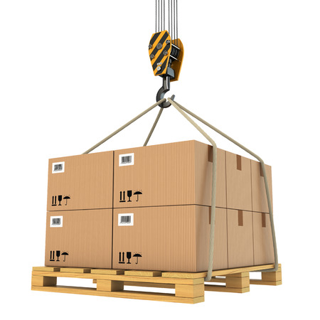 construction crane: Pallet with card boards lifted by crane