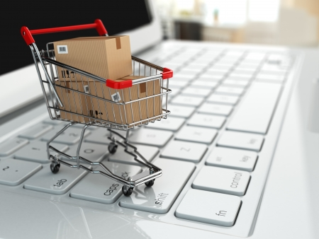 push cart: E-commerce. Shopping cart with cardboard boxes on laptop. 3d Stock Photo