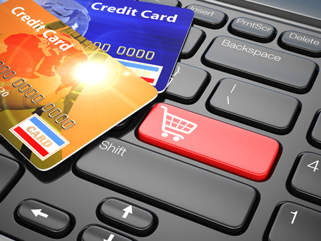 keyboard key: Online shopping. Credit card on laptop keyboard. E-commerce. 3d