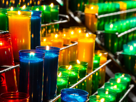 prayer candles: Burning catholic prayer candles in  transparent chandeliers Stock Photo
