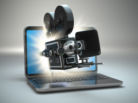 handycam: Video concept. Retro camera and  laptop. 3d Stock Photo