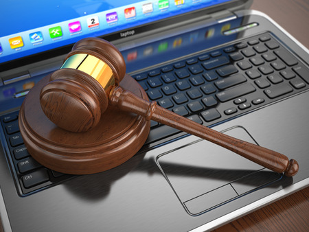 Online internet auction. Gavel on laptop.  3d photo