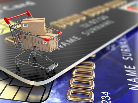 E-commerce. Shopping cart and credit cards. 3d photo