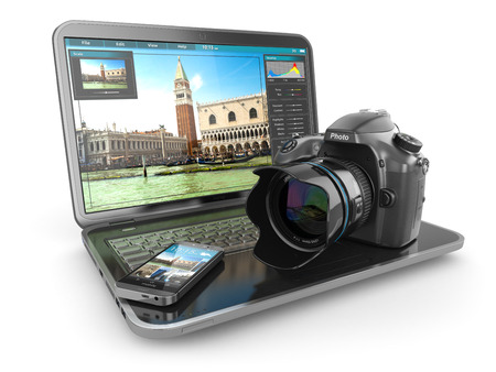 Photo camera, laptop and mobile phone. Journalist  or  traveler equipment. 3d Stock Photo