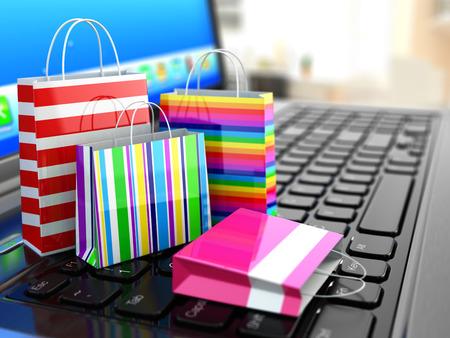 E-コマース。オンライン インター ネット ショッピング。ノート パソコンと買い物袋。3 d 写真素材