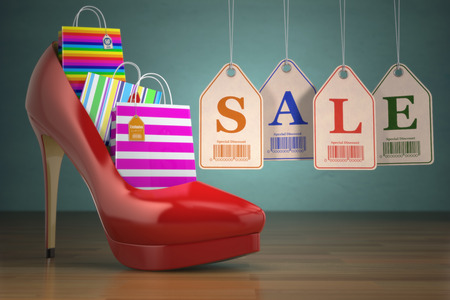 high heel shoes: Shopping bags in women high heel shoes and labels sale Stock Photo