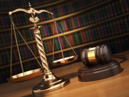 judges: Justice concept. Gavel,  golden scales and books in the library with dof effect.  3d Stock Photo
