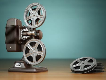 Vídeo, cine concepto. Proyector de películas de cine clásicos y carretes en el fondo verde. 3d