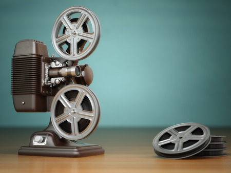 Video, cinema concept. Vintage film movie projector and reels on green background. 3d