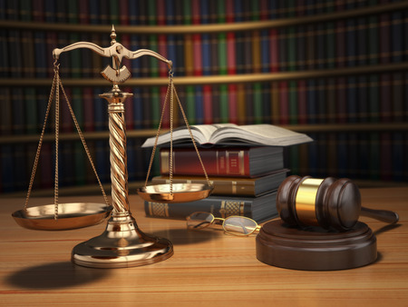 judges: Justice concept. Gavel,  golden scales and books in the library with dof effect. 3d
