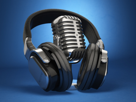 Vintage microphone and headphones on blue background. Concept audio and studio recording. 3d