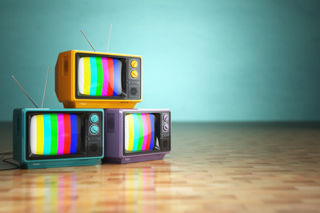 Vintage television concept. Stack of retro tv set on green background. 3d Foto de archivo