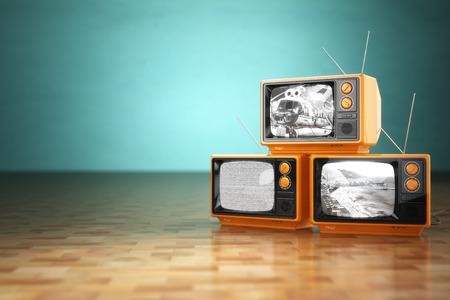 Vintage television concept. Stack of retro tv set on green background. 3d Archivio Fotografico