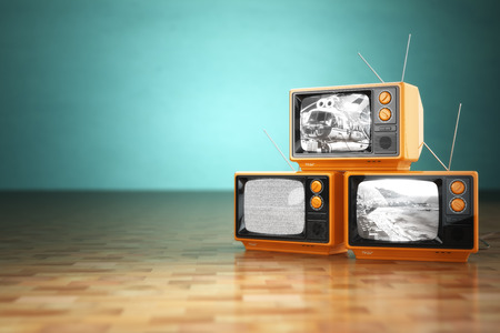 Vintage television concept. Stack of retro tv set on green background. 3d Stock Photo