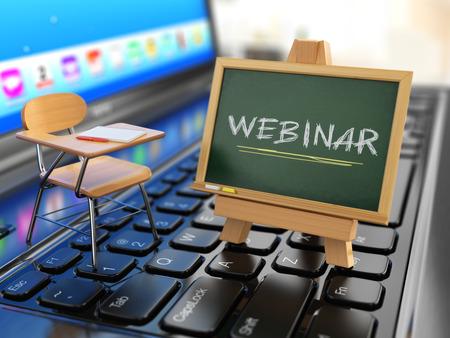 webinar: Webinar concept. Desk and chalkboard on the laptop keyboard. 3d Stock Photo