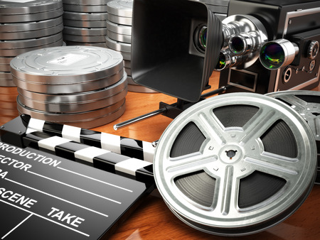 movie director: Video, movie, cinema vintage concept. Retro camera, reels and clapperboard. 3d