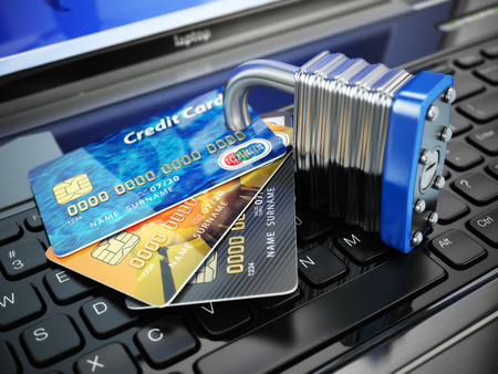 Internet security concept. Credit cards and lock on laptop keyboard. 3d