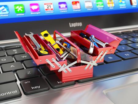 herramientas de construccion: Port�til y caja de herramientas con herramientas. Ayuda en l�nea. 3d Foto de archivo