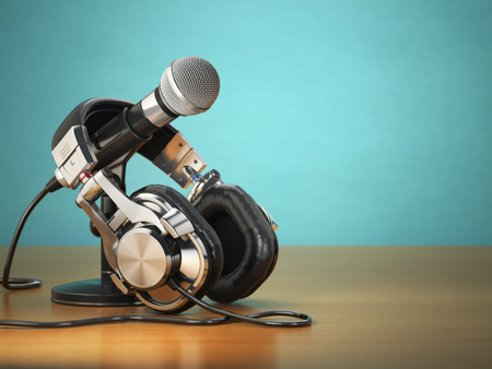 Microphone and headphones. Audio recording or radio commentator concept. 3d Stock Photo