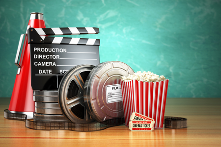Video, movie, cinema vintage production concept. Film reels, clapperboard, tickets, popcorn and megaphone. 3d