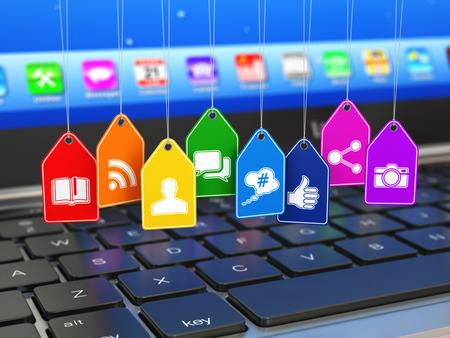 interaccion social: Los medios sociales de comunicación Internet concepto. Ordenador portátil y signos de aplicaciones en las etiquetas. 3d