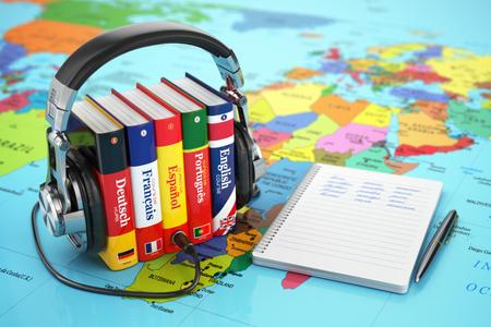 idiomas: Aprender idiomas en línea. Concepto audiolibros. Libros y auriculares en el mapa del mundo. 3d Foto de archivo