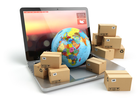 Shipping, delivery and logistic concept. Earth and cardboard boxes on laptop keyboard. Online technology. 3d 写真素材