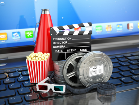 home video: Video or movie online internet concept. Film reels, clapperboard and pop corn on laptop keyboard. 3d Stock Photo