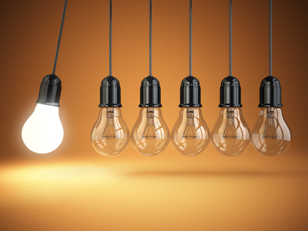 Idea o creativity concept. Light bulbs and perpetual motion. 3d Archivio Fotografico