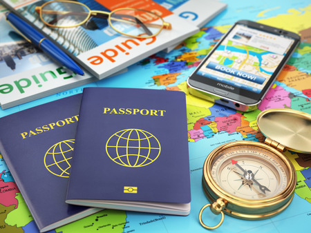 guide: Travel guide concept. Passport, compass, guide books, mobile phone on the world map. 3d