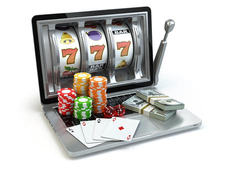 Concepto en línea de casino, juegos de azar. máquina tragaperras ordenador portátil con dados, cartas y paquetes de dólar. 3d