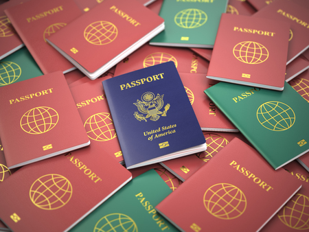 immigrate: Passport of USA on the pile of different passports. Immigration concept. USA passports. 3d