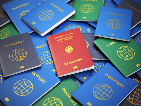 immigrate: Passport of Germany on the pile of different passports. Immigration concept. 3d