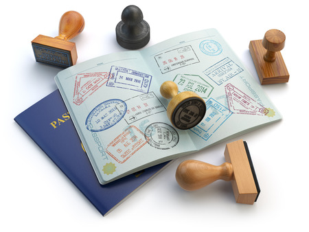 Travel or turism concept. Opened passport with visa stamps and different stampers isolated on white. 3d