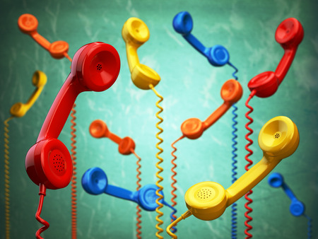 many: Telehone receivers of different colors hanging on the green background. Communication concept. 3d illustration Stock Photo