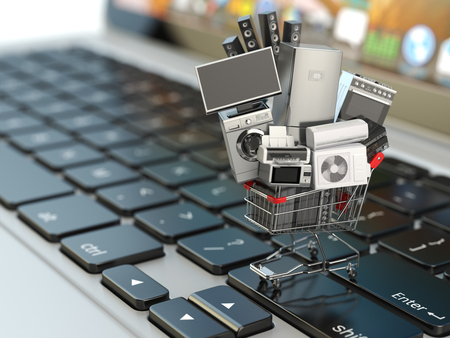 trolley: E-commerce or online shopping concept. Home appliance in shopping cart on the laptop keyboard. 3d illustration