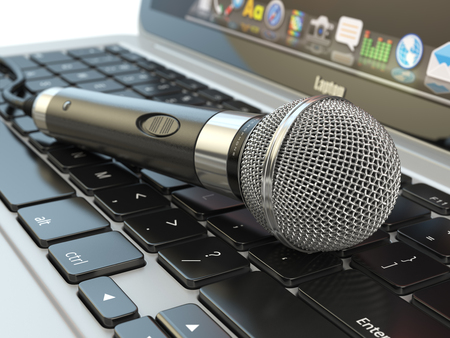 newsgroup: Microphone on the laptop keyboard. Digital audio  music software or karaoke concept. 3d illustration