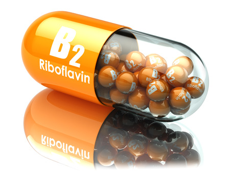 Vitamin B2 capsule. Pill with riboflavin. Dietary supplements. 3d illustration Foto de archivo