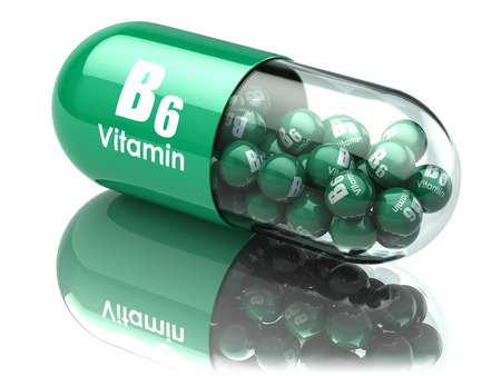 vitamins: Vitamin B6 capsule or pill. Dietary supplements. 3d illustration