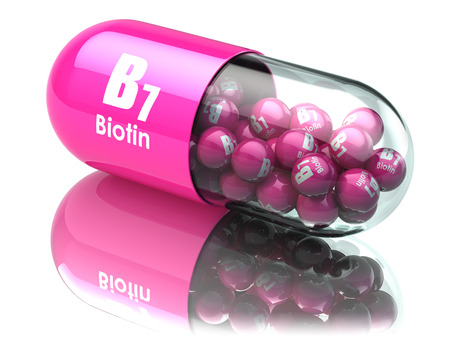 dietary supplements: Vitamin B7 capsule. Pill with biotin. Dietary supplements. 3d illustration Stock Photo
